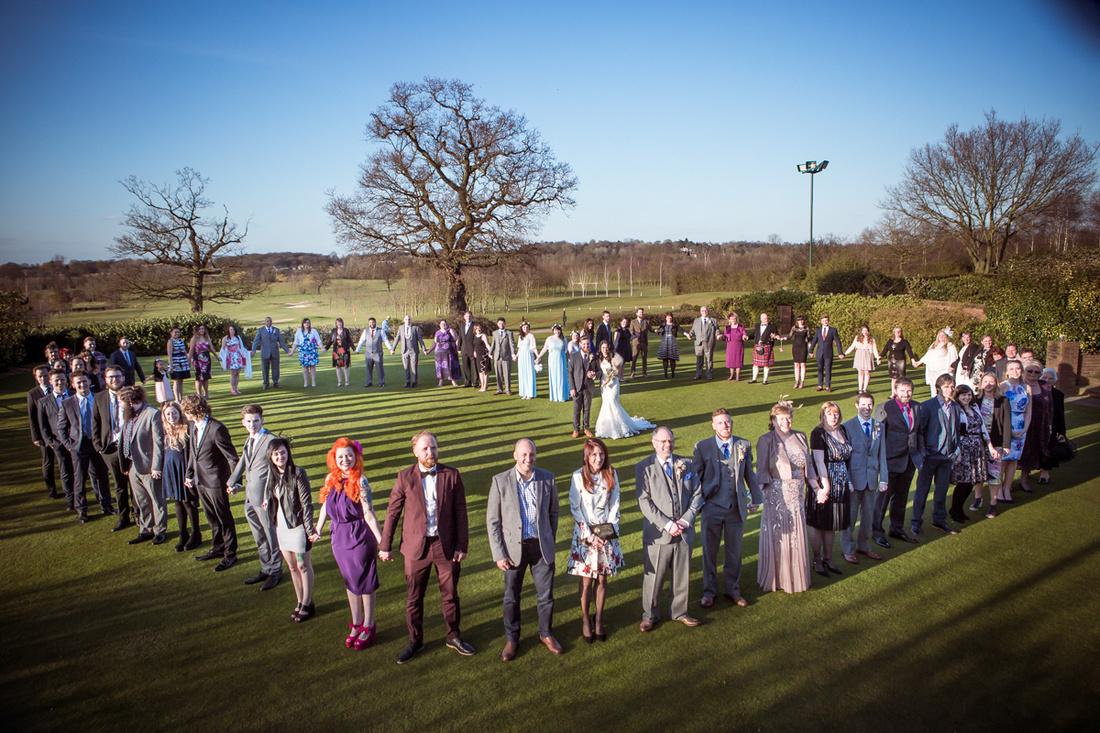Heart shape wedding group photo | Essex