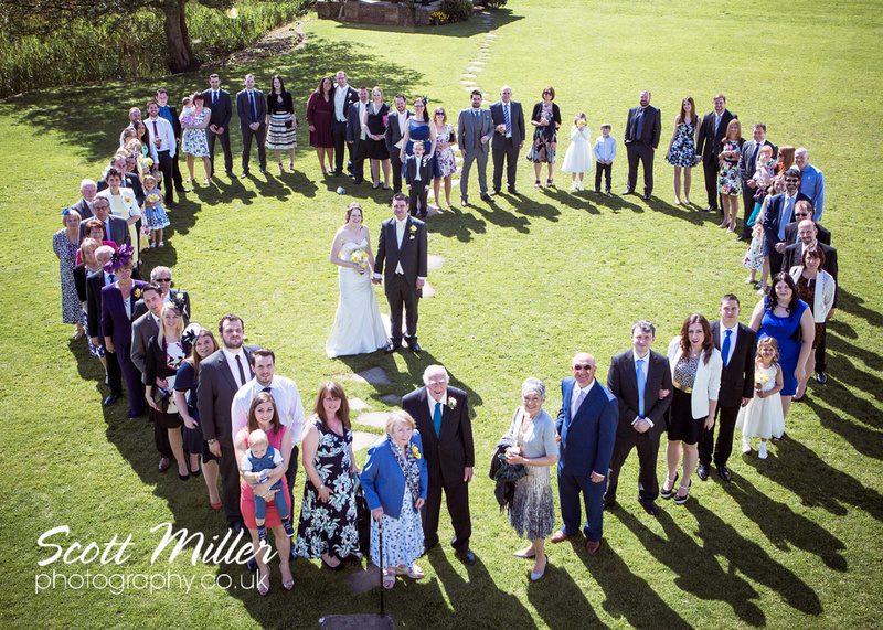 Prested Hall wedding photography | Colchester | Heart shape group shot